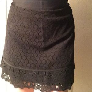 Black skirt with lace-like overlay